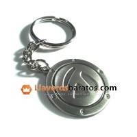 Llavero metálico con forma redonda y relieves.